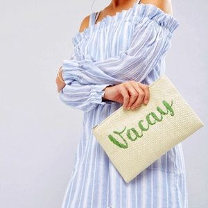 Vacay woven straw clutch bag